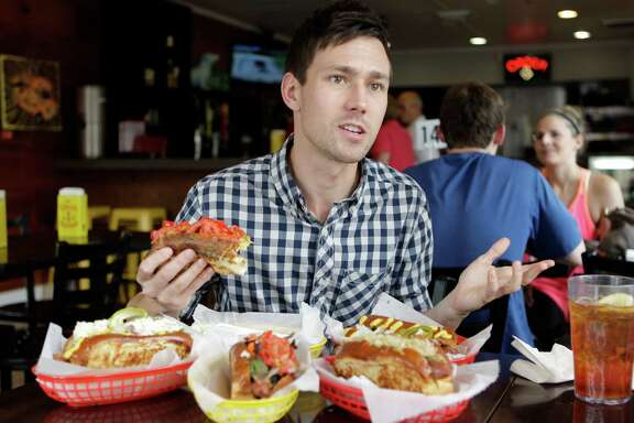 """Russell van Kraayenburg, the author of """"Haute Dogs,"""" a new hot dog cookbook, talks about his book and hot dogs at Good Dog Houston, 903 Studewood, Friday, Aug. 1, 2014, in Houston. ( Melissa Phillip / Houston Chronicle )"""