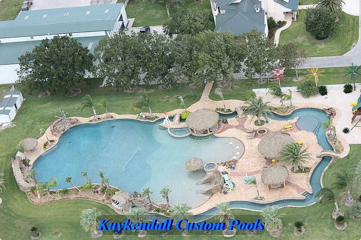 This Texas backyard boasts the world's largest residential swimming pool. Check out the awesome summertime addition and keep clicking to see some of the coolest pools around Houston.