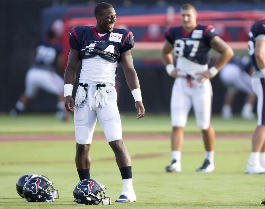 Running back Alfred Blue (44) laughs as he walks onto the practice field. Photo: Brett Coomer, Houston Chronicle