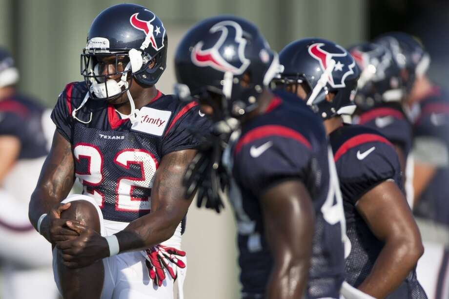 Running back Ronnie Brown (22) stretches. Photo: Brett Coomer, Houston Chronicle