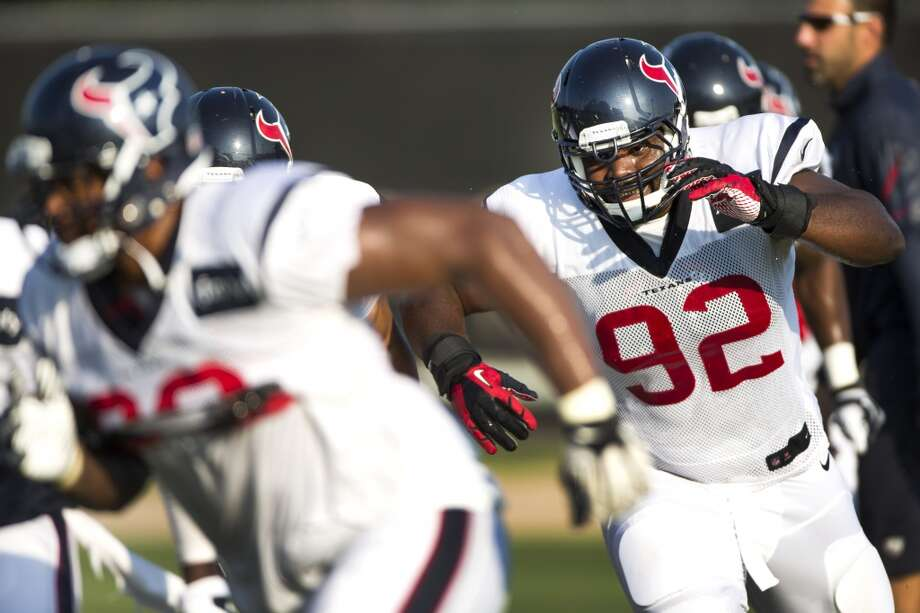 Defensive tackle Louis Nix III (92) runs through a pass rush drill. Photo: Brett Coomer, Houston Chronicle