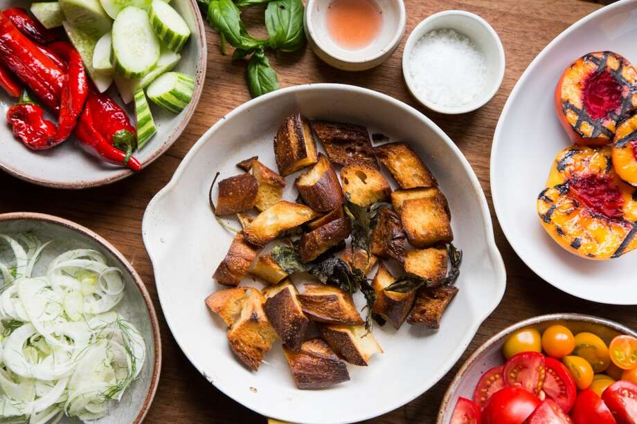 Melissa Perello, chef at Frances restaurant, uses a variety of ingredients for a panzanella salad including toasted levain bread, grilled stone fruit, fennel, tomatoes, peppers and cucumbers at her home in San Francisco. Photo: Jason Henry, Special To The Chronicle