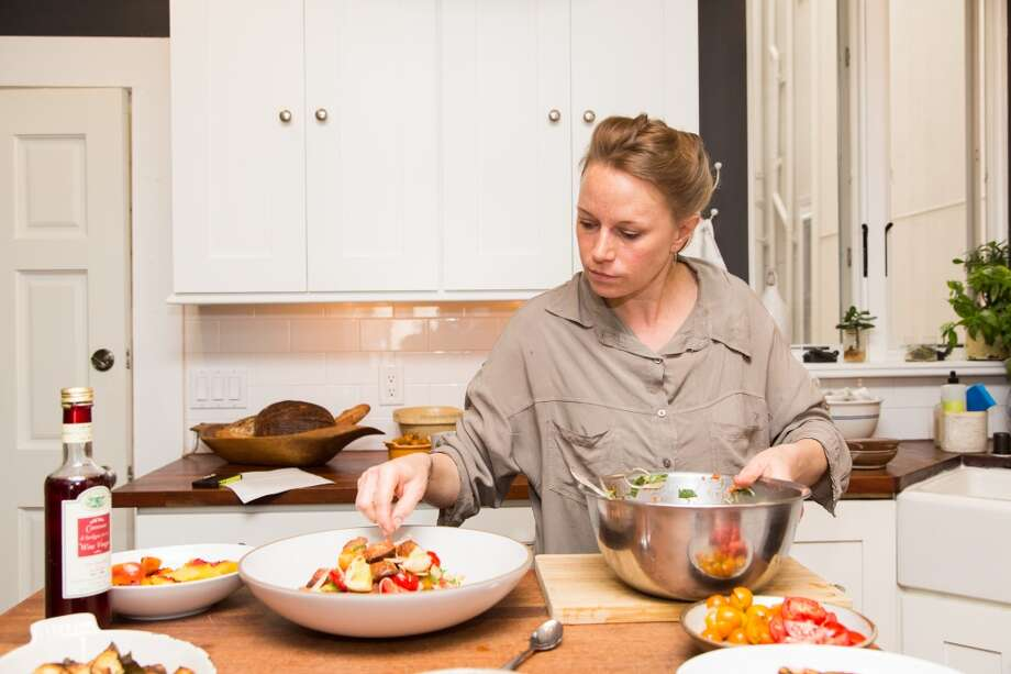 Melissa Perello, chef at Frances restaurant, plates a panzanella salad. Photo: Jason Henry, Special To The Chronicle