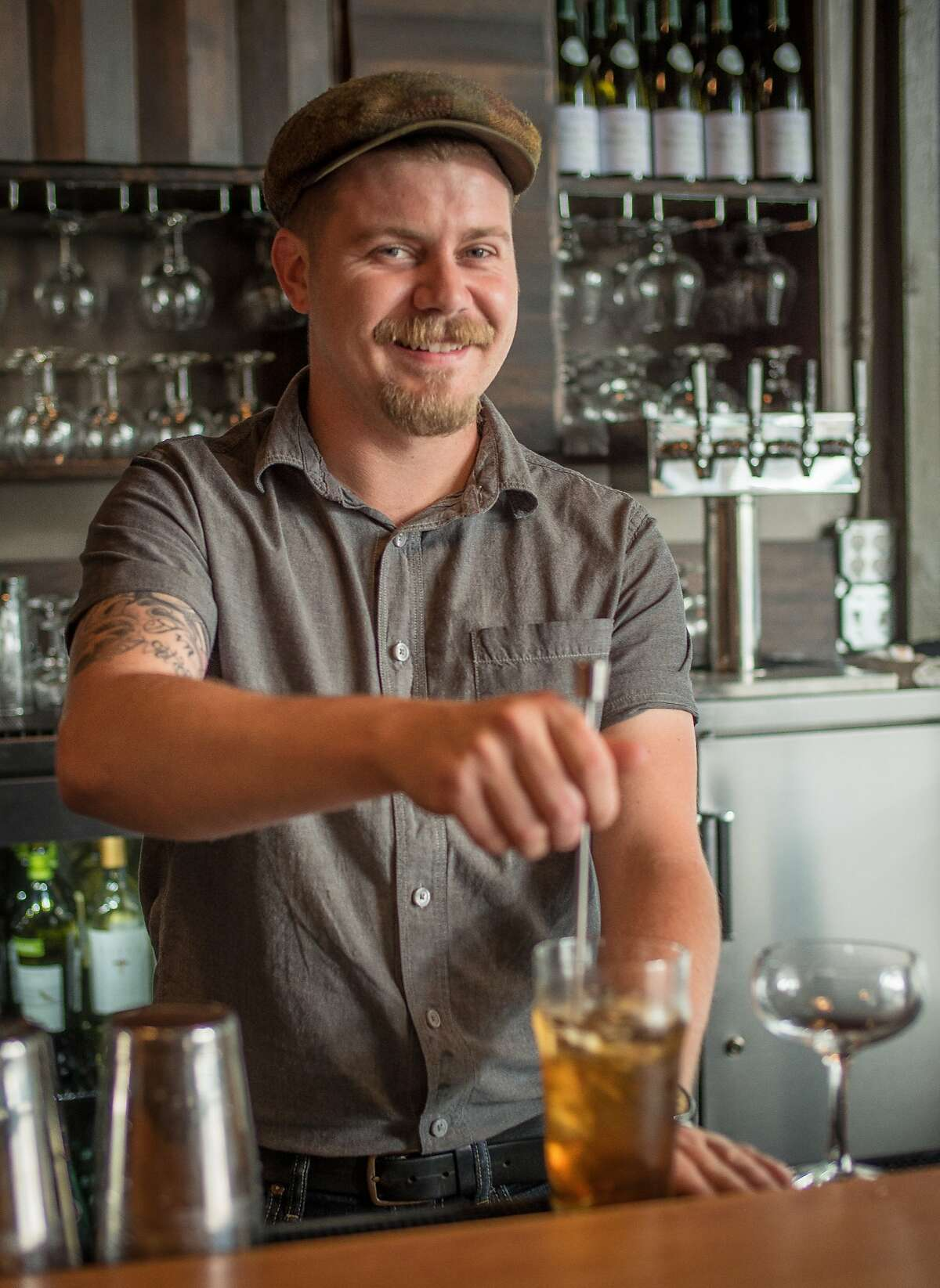 Bartnder Tyler Groom stirs a cocktail at Stones Throw in San Francisco, Calif. on August 6th, 2014.