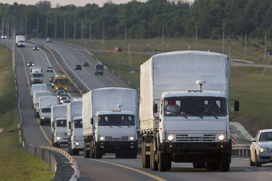 A convoy of trucks carrying humanitarian aid items passes along the main road through Russia's Voronezh region toward eastern Ukraine. Photo: Pavel Golovkin, Associated Press