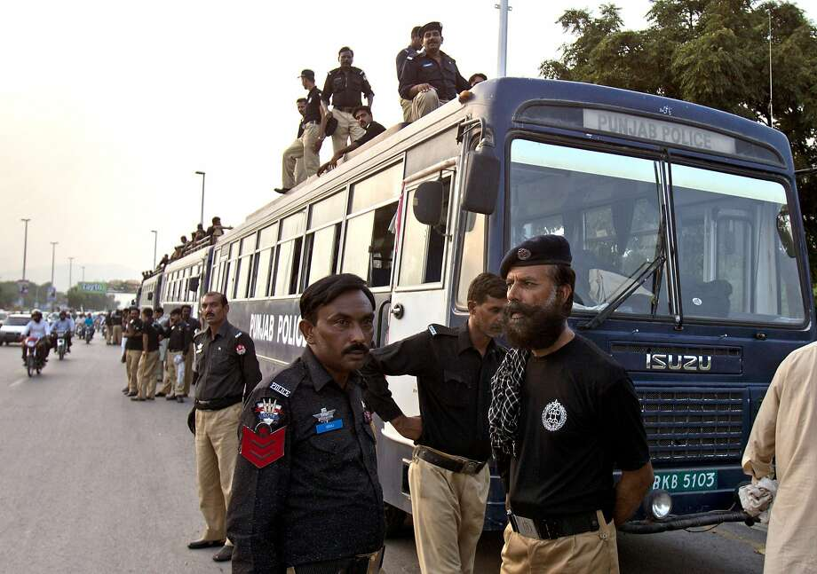 Pakistani police deploy in Islamabad in preparation for antigovernment protests planned for Thursday. Photo: B.K. Bangash, Associated Press