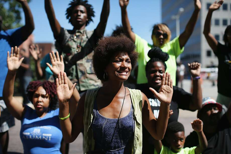 "Protesters chant ""hands up, don't shoot"" during a rally over the killing of Michael Brown in Ferguson, Mo. Photo: Scott Olson, Getty Images"