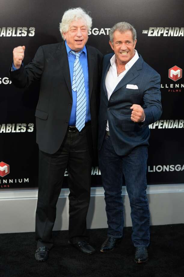 "Producer Avi Lerner (L) and actor Mel Gibson pretend to fight as they attend the premiere of ""The Expendables 3' at the TCL Chinese Theatre on August 11, 2014 in Hollywood, California. Photo: MARK RALSTON, AFP/Getty Images"