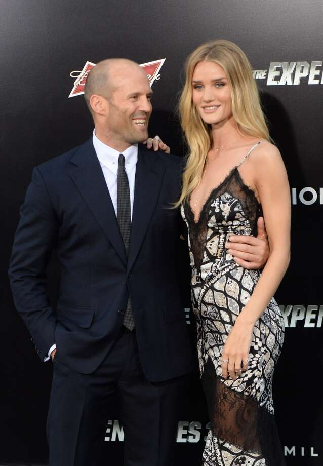 "Actor Jason Statham and Rosie Huntington-Whiteley attend the premiere of ""The Expendables 3' at the TCL Chinese Theatre on August 11, 2014 in Hollywood, California. Photo: MARK RALSTON, AFP/Getty Images"