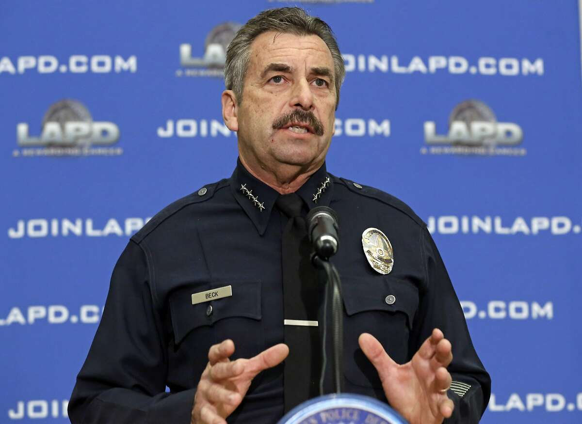 FILE - This Feb. 4, 2014 file photo shows Los Angeles Police Chief Charlie Beck speaks at a news conference at LAPD headquarters in Los Angeles. Beck on Tuesday, Aug. 12, 2014 was reappointed to a second five-year term by the department's civilian oversight commission. (AP Photo/Reed Saxon, File)