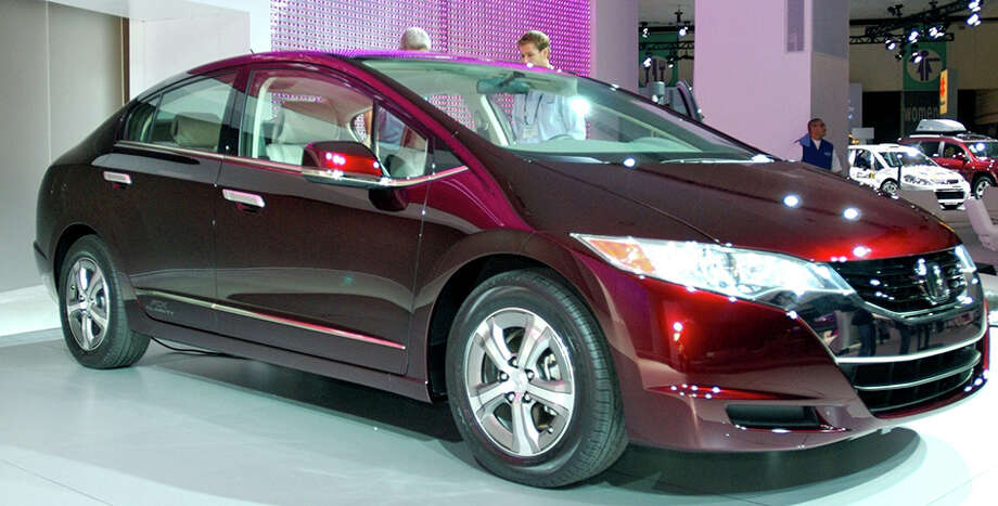 Fuel Cell cars have not caught on because creating hydrogen has turned out to be highly inefficient compared to other readily available fuels and would also require an enormous and costly infrastructure. Above, a demonstration Honda FCX Clarity produced in 2008. Photo: Contributed Photo, Contributed / New Canaan News Contributed