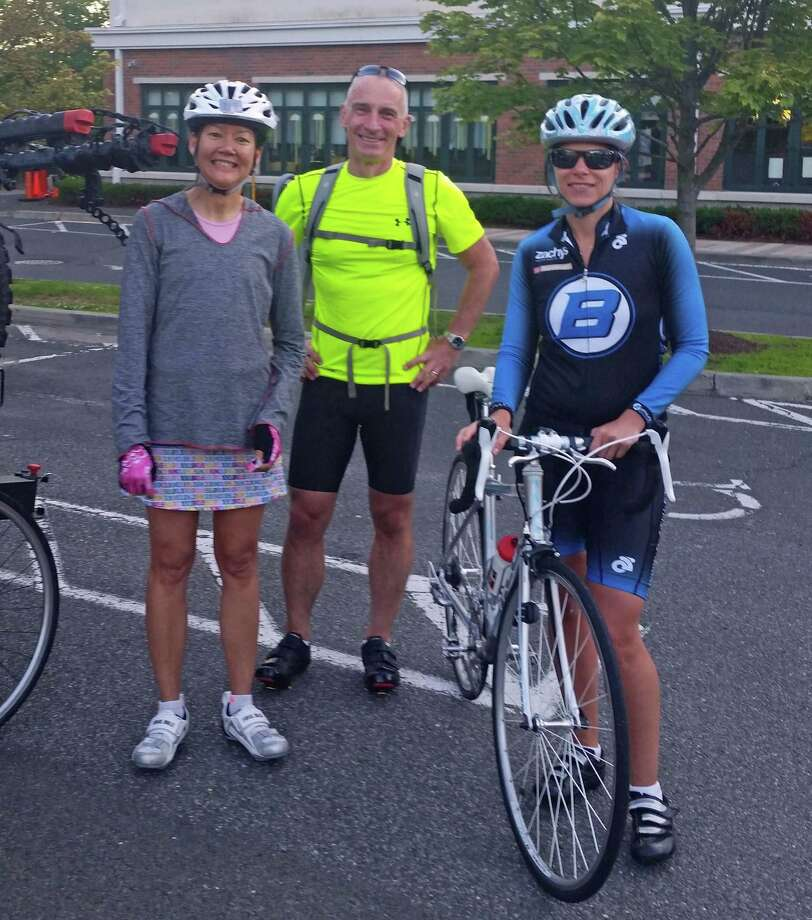 From left, Trisha Rozas, Fillip Roseel and Mariella Montoni are members of the New Canaan YMCA's Y Tri Club. Participants train and complete multi-sport events together. Photo: Contributed Photo, Contributed / New Canaan News Contributed