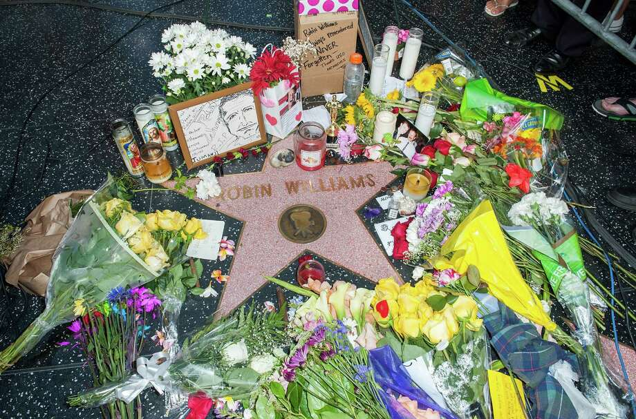 Flowers are placed on Robin Williams Hollywood Walk of Fame star on August 12, 2014 in Los Angeles, California. Photo: Valerie Macon, Valerie Macon/Getty Images / 2014 Getty Images