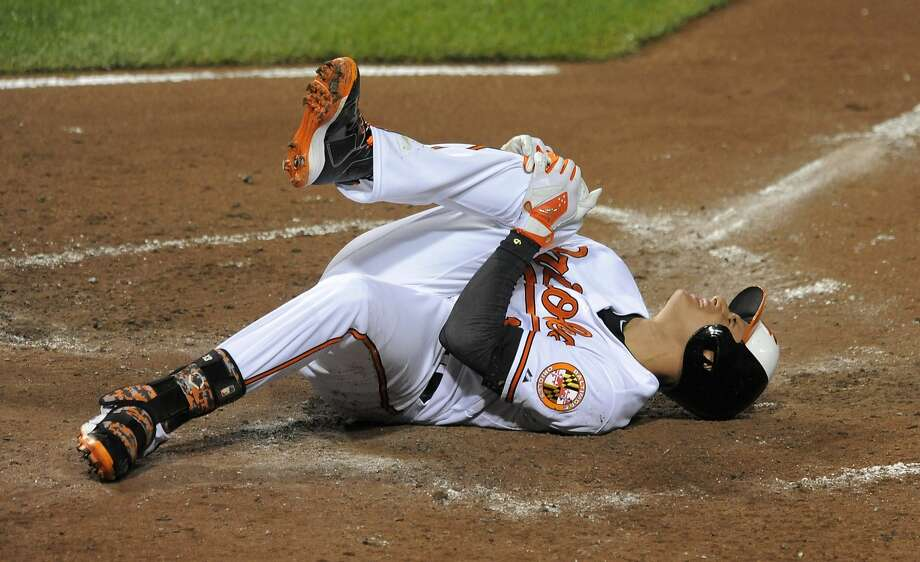 Baltimore Orioles' Manny Machado holds his right knee after grounding out during the third inning of the team's game against the New York Yankees on Monday, Aug. 11, 2014, at Camden Yards in Baltimore. (Lloyd Fox/Baltimore Sun/MCT) Photo: Lloyd Fox, McClatchy-Tribune News Service