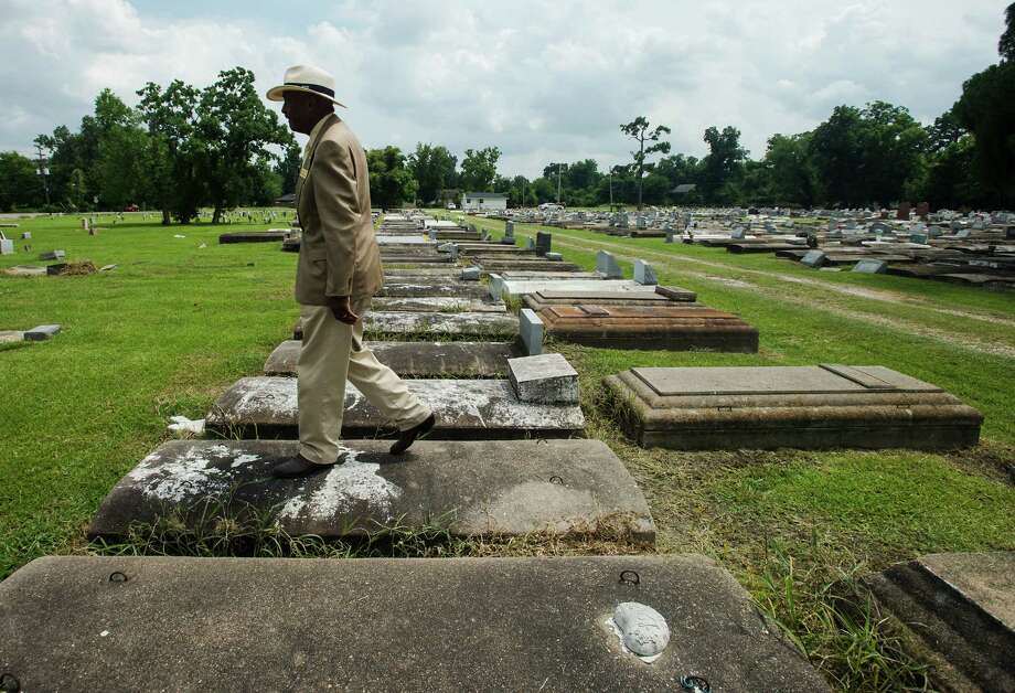 Donald Taft walks through Greenlawn Cemetery on Tuesday afternoon. Taft, owner of Community Cemeteries, Inc., is expanding one of his company's burial grounds to Magnolia Street. Photo taken Tuesday 7/29/14 Jake Daniels/@JakeD_in_SETX Photo: Jake Daniels / ©2014 The Beaumont Enterprise/Jake Daniels