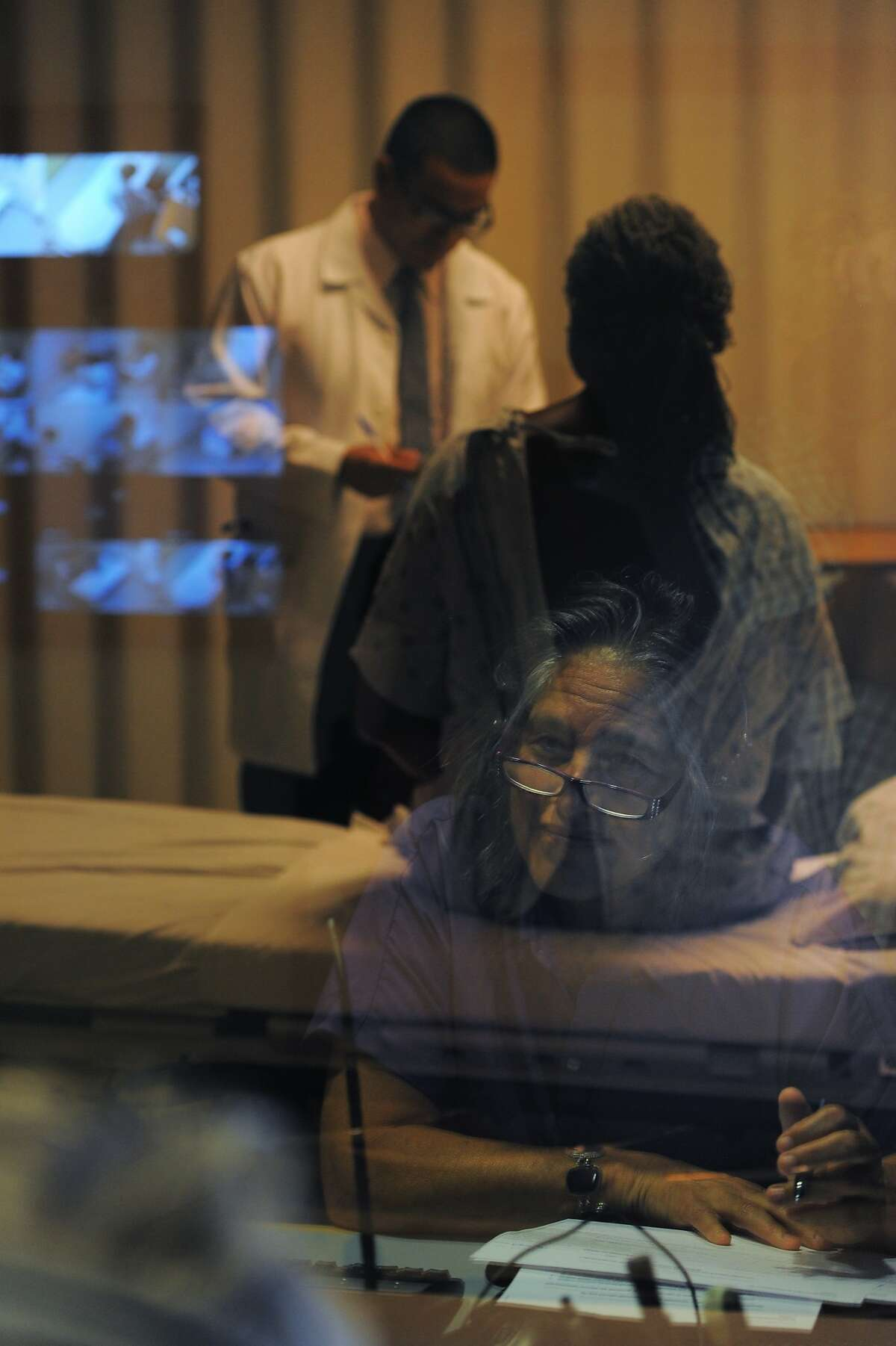 Doctor Susan Lindheim, watches medical student Abraham Vela