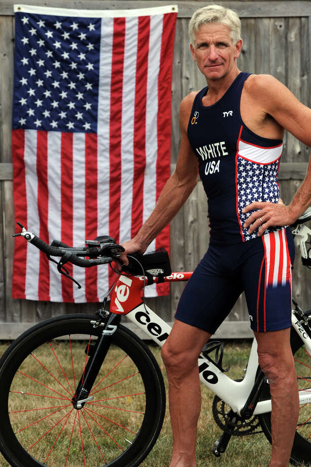 Dennis White, of Stratford, is a triathlete who will be representing the U.S. in the World Championships in a few weeks in Canada. He is seen here at home, Aug. 12, 2014. Photo: Ned Gerard / Connecticut Post