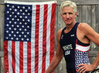 Dennis White, of Stratford, is a triathlete who will be representing the U.S. in the World Championships in a few weeks in Canada. He is seen here at home, Aug. 12, 2014.