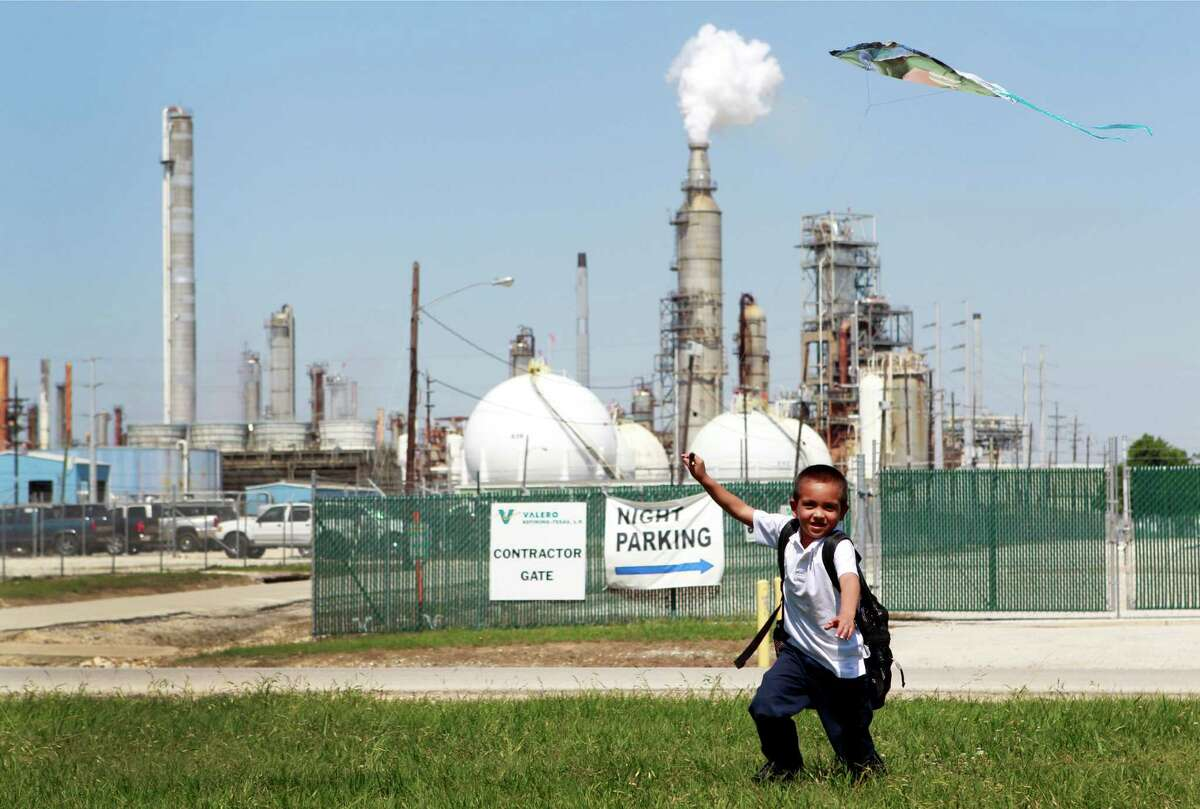 Joshua Martinez, 6, flies a kite in his aunt's yard across from the Valero Houston Refinery earlier this month.