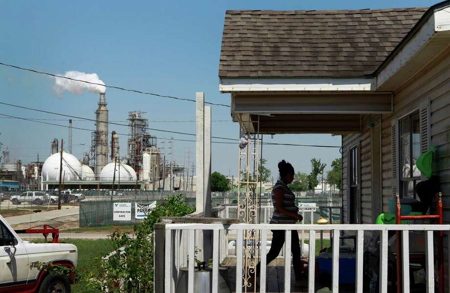 Griselda Silva walks into her sister's home along East Avenue P at Central St. across from the Valero Houston Refinery Thursday, May 15, 2014, in Houston.  Photo: Melissa Phillip, Staff / © 2014  Houston Chronicle