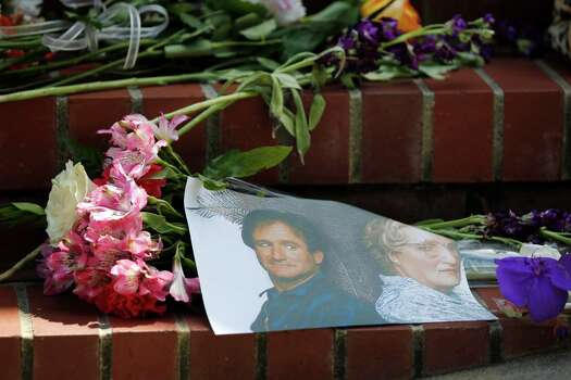 "Flowers, notes and photographs line the steps of a temporary shrine for Robin Williams August 12, 2014 at the home where ""Mrs. Doubtfire"" was filmed in San Francisco. Williams was found dead in his home on Monday. Photo: Leah Millis / Leah Millis / The Chronicle / ONLINE_YES"