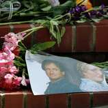 "Flowers, notes and photographs line the steps of a temporary shrine for Robin Williams August 12, 2014 at the home where ""Mrs. Doubtfire"" was filmed in San Francisco. Williams was found dead in his home on Monday."