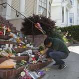 "Chris Villanueva, 24, lights candles at a temporary shrine that has come into existence in the past 24 hours since the news of Robin Williams' death has spread August 12, 2014 at the home where ""Mrs. Doubtfire"" was filmed in San Francisco, Calif. Williams was found dead in his home on Monday. ""He was able to give the bay area some pride."" Villanueva said."