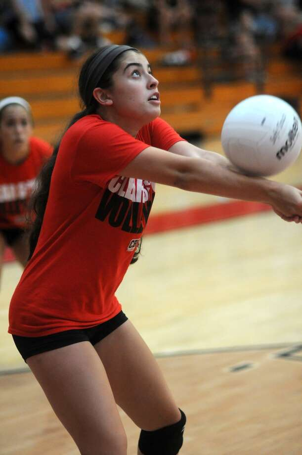 Clear Brook senior setter Victoria Santos makes a play against La Porte during a four-way scrimmage at Clear Brook High School last week. Photo: Jerry Baker, Freelance