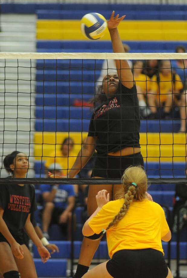Westfield sophomore middle blocker Symone Merritt works the ball against St. Agnes during their scrimmage at Klein High School. Photo: Jerry Baker, Freelance