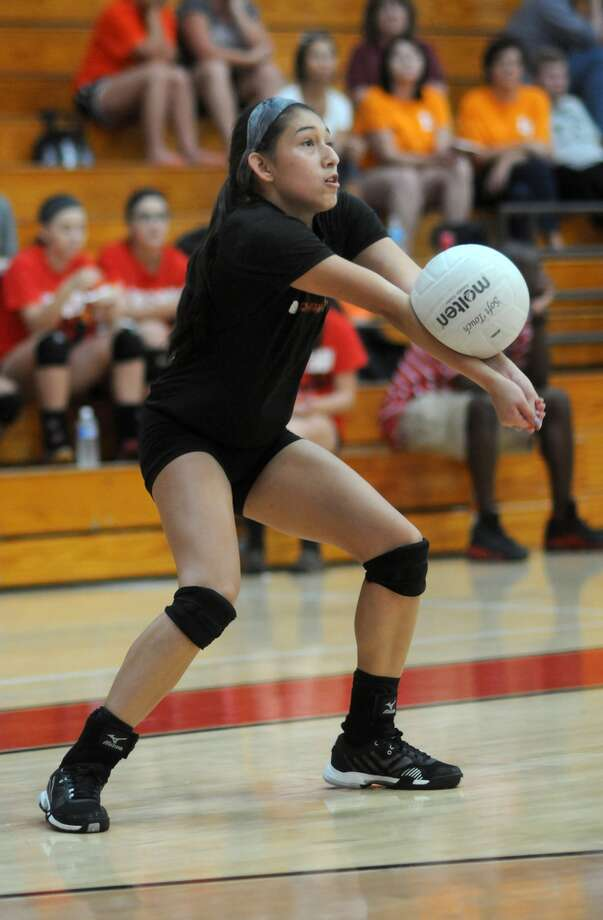 Dobie  junior libero and outside hitter Ashley Perez makes a pass against La Porte during a four-way scrimmage at Clear Brook High School. Photo: Jerry Baker, Freelance