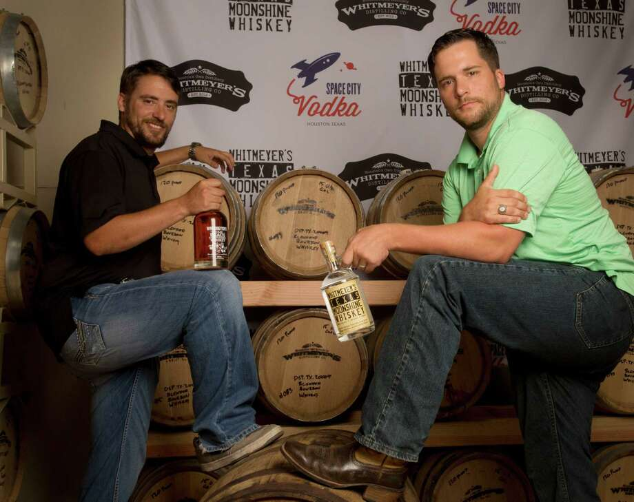 Brothers Travis, left, and Chris Whitmeyer had a dream to craft their own spirits. Now they own and operate Whitmeyer's Distillery in northwest Houston, where they make whiskey and vodka. Photo: Billy Smith II, Staff / © 2014 Houston Chronicle