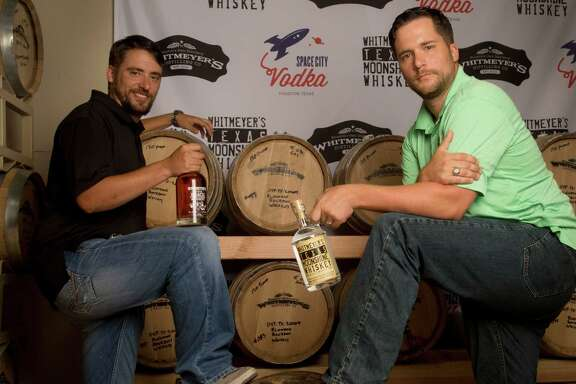 Brothers Travis, left, and Chris Whitmeyer had a dream to craft their own spirits. Now they own and operate Whitmeyer's Distillery in northwest Houston, where they make whiskey and vodka.