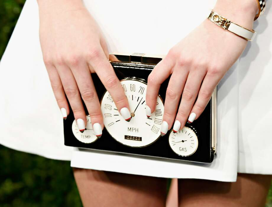 Kate Spade, maker of high-end purses like this, is seeing its growth slow. The stock fell 25 percent. Photo: Cindy Ord, Getty Images