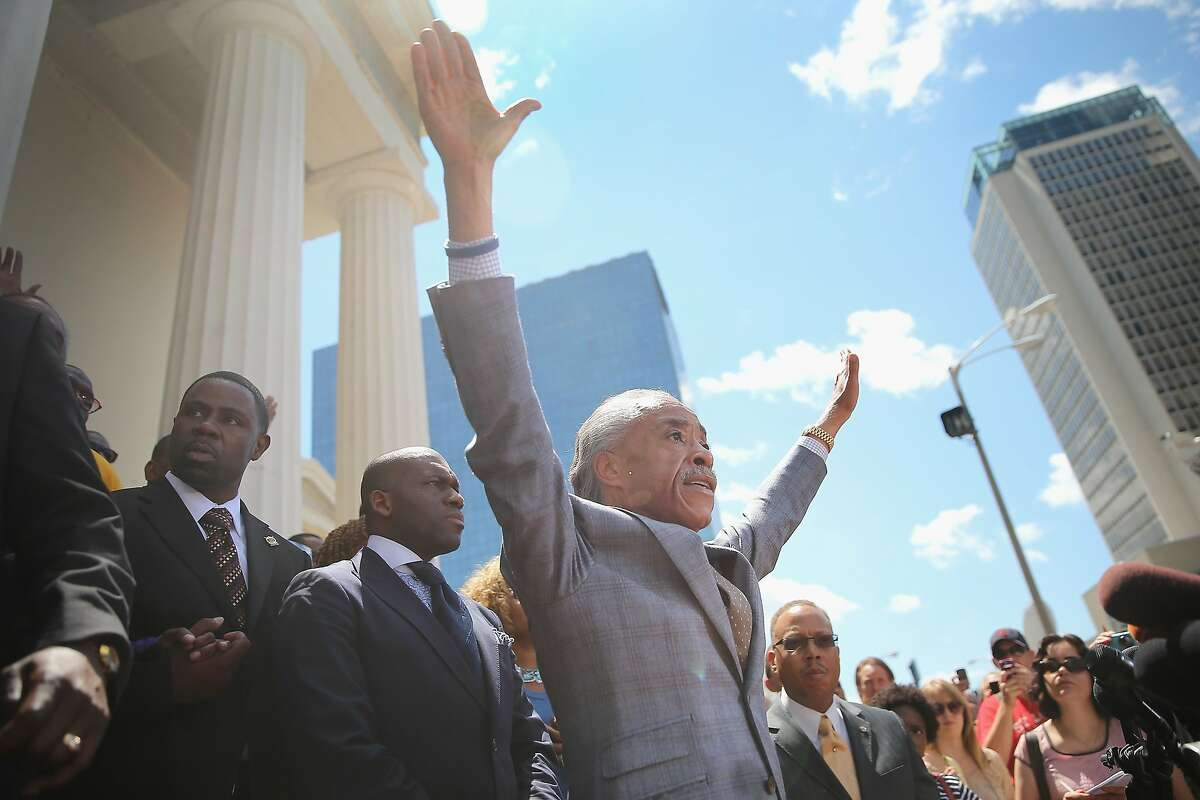 ST. LOUIS, MO - AUGUST 12: Civil rights leader Rev. Al Sharpton speaks about the killing of teenager Michael Brown at a press conference held on the steps of the old courthouse on August 12, 2014 in St. Louis, Missouri. When their hands are up you don't shoot, exclaimed Sharpton, who was referring to reports that Brown was shot while his hands were raised in the air. Brown was shot and killed by a police officer on Saturday in suburban Ferguson, Missouri. Sharpton and Browns family were calling for order following riots and skirmishes with police over the past two nights in Ferguson by demonstrators angry over the shooting. (Photo by Scott Olson/Getty Images)