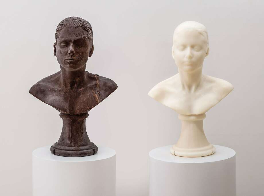 """Lick and Lather"" (1993-94) self-portrait busts in chocolate and soap by Janine Antoni in ""Gorgeous,"" through Sept. 14, Asian Art Museum, San Francisco. (415) 581-3500, www.asianart.org. SFMOMA Gorgeous Lick and Lather EX 2014.1.1.a-.b Lick and Lather, 1993–1994, by Janine Antoni (Bahamian, b. 1964.) Two self-portrait busts: one chocolate and one soap. Collection of Carla Emil and Rich Silverstein and SFMOMA (John Caldwell, Curator of Painting and Sculpture, 1989–93, Fund for Contemporary Art purchase), 2007.97.A-B. © Janine Antoni. Photo: Unknown"