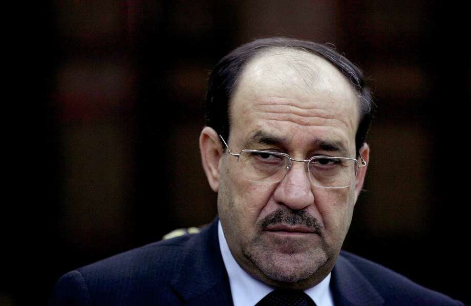 FILE - In this Wednesday, Feb. 27, 2013, file photo, Iraqi Prime Minister Nouri al-Maliki listens to a question during an interview with The Associated Press in Baghdad. On Tuesday, Aug. 12, 2014, al-Maliki ordered security forces not to intervene in the current political crisis over who will be the next prime minister, but rather focus on defending the country, which is under attack by Sunni militants in the north. (AP Photo/ Khalid Mohammed, File) Photo: Khalid Mohammed, STF / AP