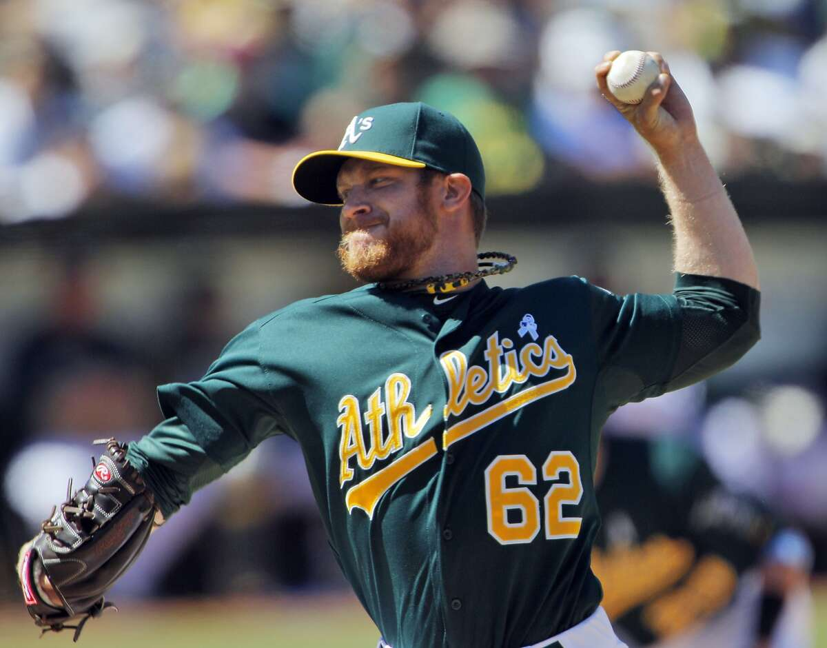 Sean Doolittle pitches in the eighth inning, relieving Bartolo Colon. The Oakland Athletics played the Seattle Mariners at O.co Coliseum in Oakland, Calif., on Sunday, June 16, 2013.