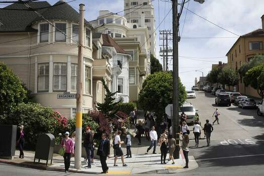 "Onlookers mill around and photograph a temporary shrine for the late Robin Williams August 12, 2014 at the home where ""Mrs. Doubtfire"" was filmed in San Francisco, Calif. Williams was found dead in his home on Monday. Photo: Leah Millis, The Chronicle"