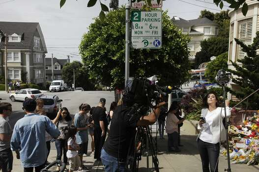 """ABC's Cecilia Vega prepares for a live shot outside of a temporary shrine for the late Robin Williams August 12, 2014 at the home where """"Mrs. Doubtfire"""" was filmed in San Francisco, Calif. Williams was found dead in his home on Monday. Photo: Leah Millis, The Chronicle"""