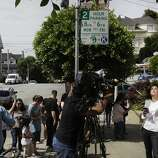 "ABC's Cecilia Vega prepares for a live shot outside of a temporary shrine for the late Robin Williams August 12, 2014 at the home where ""Mrs. Doubtfire"" was filmed in San Francisco, Calif. Williams was found dead in his home on Monday."