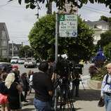 "Media prepare for live shots as onlookers photograph a temporary shrine for the late Robin Williams August 12, 2014 at the home where ""Mrs. Doubtfire"" was filmed in San Francisco, Calif. Williams was found dead in his home on Monday."