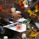 "David Rabb, 45, picks up a candle to light it in front of a temporary shrine for the late Robin Williams August 12, 2014 at the home where ""Mrs. Doubtfire"" was filmed in San Francisco, Calif. Williams was found dead in his home on Monday."