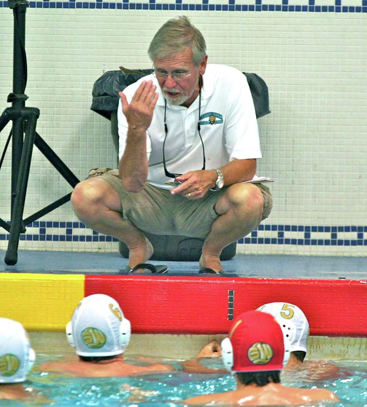 Greenwich Water Polo coach Terry Lowe talks to his team at the recent Junior Olympic Qualifier held at the United States Naval Academy in Annapolis, MD.