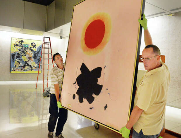 "Technicians Harry Klein, left, and Rob Conzett of the Williamstown Art Conservation Center move Adolph Gottlieb's ""Orange Glow,"" a 1967 oil on canvas, on the Concourse level of the Corning Tower as portions of the Empire State Plaza Art Collection are reinstalled to different locations on the Concourse and Corning Tower Tuesday August 12, 2014, in Albany, NY.  (John Carl D'Annibale / Times Union) Photo: John Carl D'Annibale, Albany Times Union / 00028130A"