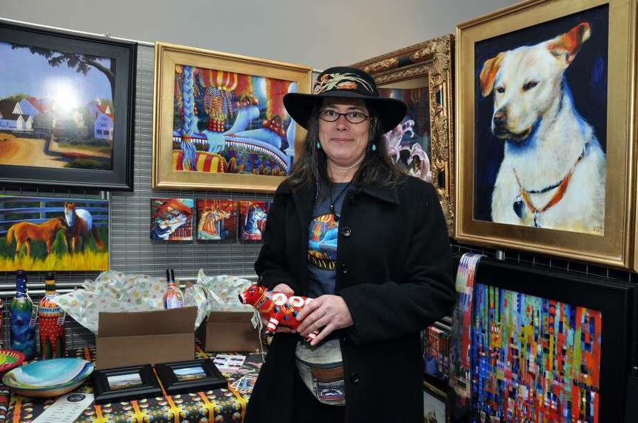 Susan O'Neill, of Norwalk, speacilizes in pet and house portrait commissions. O'Neill's booth also offers gift items such as handpainted banks, wine bottles and bowls. Photo: Amy Mortensen / Connecticut Post
