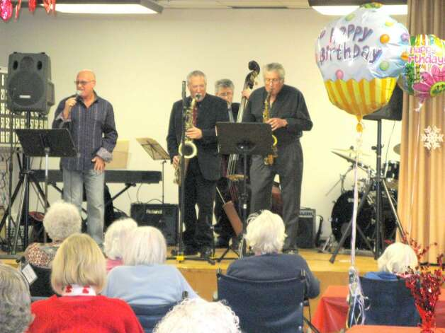 Serenading residents and guests at Nathaniel Witherell on Valentine's Day was the Bill Harris jazz quartet with special guest Dr. John Tamerin on the saxophone, far right. Photo: Anne W. Semmes / Greenwich Citizen