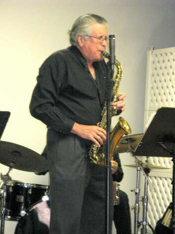 Psychiatrist, Dr. John Tamerin, a saxophone playing student of Bill Harris, played with passion before residents and guests including his wife, Susan. Photo: Anne W. Semmes / Greenwich Citizen