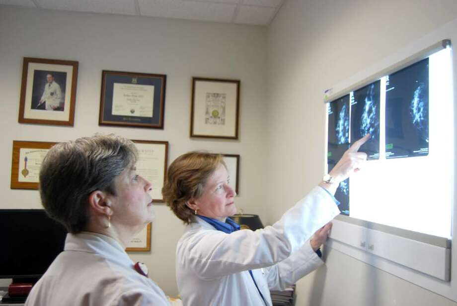 Dr. Barbara Ward, director of the Greenwich Hospital Breast Center, discusses a mammogram with Jan Larkin, R.N., Nurse Navigator for the Center. Photo: Julie Ruth / Greenwich Citizen
