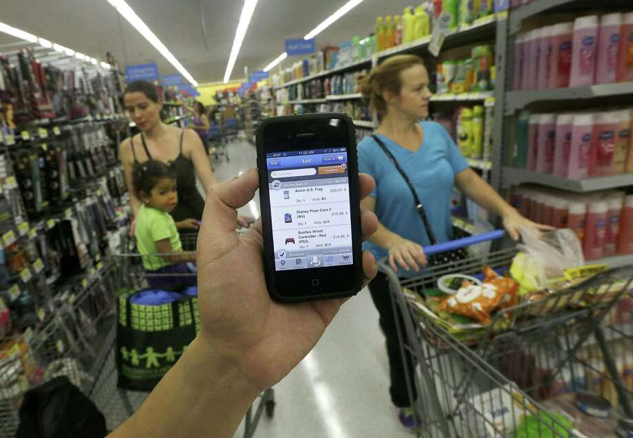 The Scan & Go smartphone app tanked, but Wal-Mart discovered useful inform-ation about its customers in the process - they like being able to track spending. Photo: Jeff Chiu, STF / AP