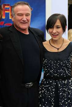 (FILES) This file photo taken on November 13, 2011 shows US actor Robin Williams and his daughter Zelda posing on arrival for the world premiere of the movie 'Happy Feet Two' in Hollywood in southern California. Oscar-winning actor and comedian Robin Williams died from suspected suicide on August 11, 2014 after battling depression, triggering an outpouring of tributes to one of the most beloved entertainers of his generation.         AFP PHOTO / FILES / Frederic J. BROWNFREDERIC J. BROWN/AFP/Getty Images Photo: Frederic J. Brown, AFP/Getty Images